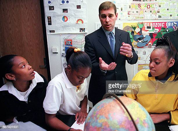 His Royal Highness Prince Andrew The Duke of York talks to students LaDawn Slack Genesis White and Karena Ward about project they were doing on...