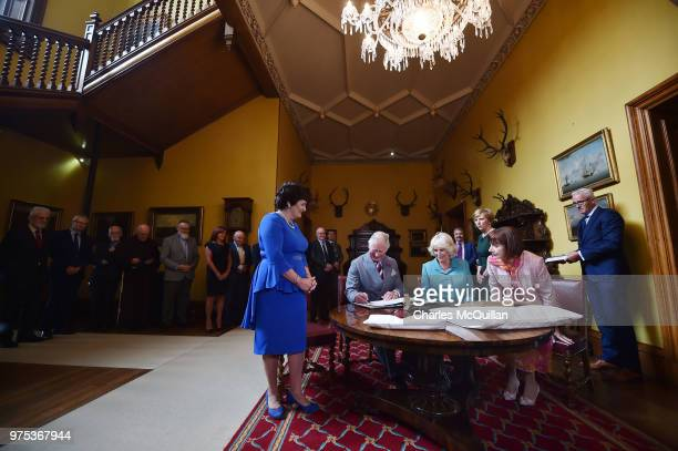 His Royal Highness Prince Charles and Her Royal Highness the Duchess of Cornwall sign the visitors book on their visit to Muckross House on June 15...