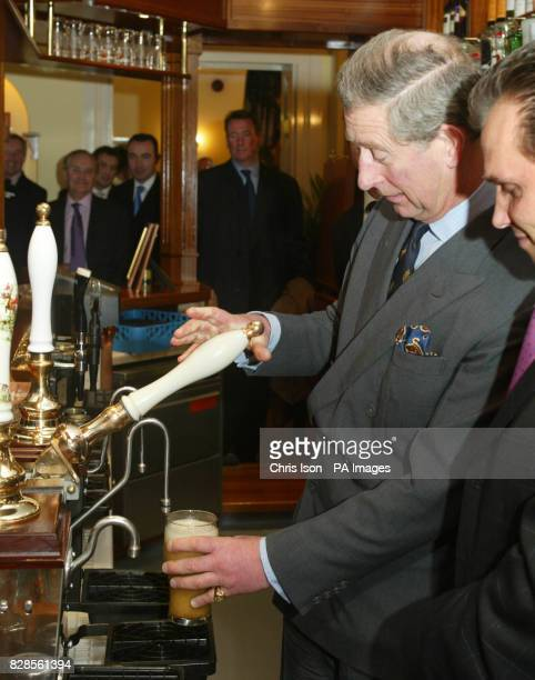 His Royal Highness Prince Charles pulls a pint of beer during his visit to the village of Poundbury in Dorset * The Prince officially opened the Poet...