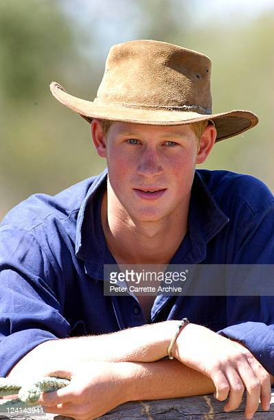His Royal Highness Prince Harry poses for photographs after herding bulls while working as a Jackaroo on a cattle ranch on November 27 2003 in...