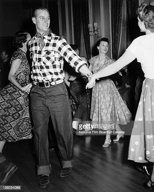 His Royal Highness Prince Philip Duke of Edinburgh enjoys an oldfashioned hoedown held in the honour of the Royal Couple at Rideau Hall Ottawa...