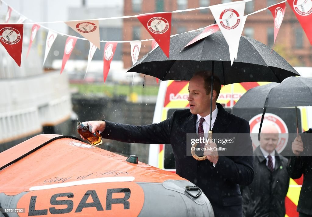 His Royal Highness Prince William, the Duke of Cambridge pours a measure of whiskey onto 'Ray of Hope' as he dedicates a new lifeboat to the Lagan Search and Rescue service as he visits the Titanic Quarter during His Royal Highness' one day visit to the province on October 4, 2017 in Belfast, Northern Ireland. His Royal Highness is on a one day visit to the province.