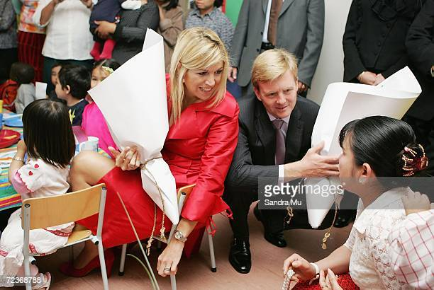 His Royal Highness The Prince of Orange and Princess Maxima of The Netherlands receive flowers during a visit to the creche at Selwyn College on the...
