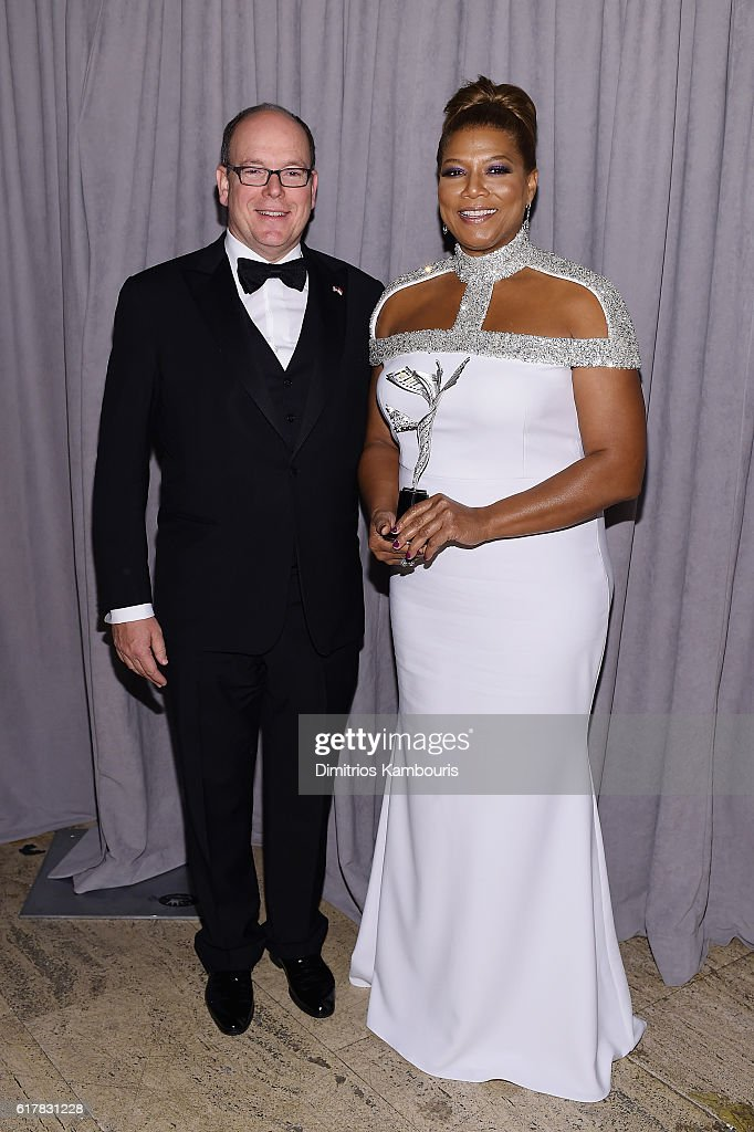 His Serene Highness Prince Albert II of Monaco (L) and 2016 Princess Grace Statue Award Recipient Queen Latifah attend the 2016 Princess Grace Awards Gala with presenting sponsor Christian Dior Couture at Cipriani 25 Broadway on October 24, 2016 in New York City.