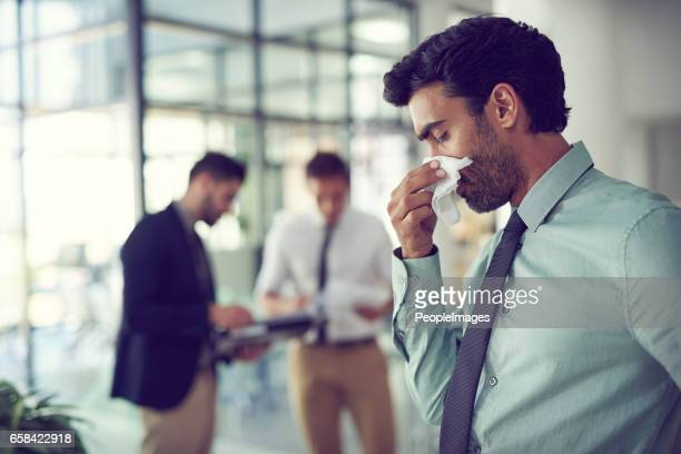 his sinuses are acting up - infectious disease stock pictures, royalty-free photos & images