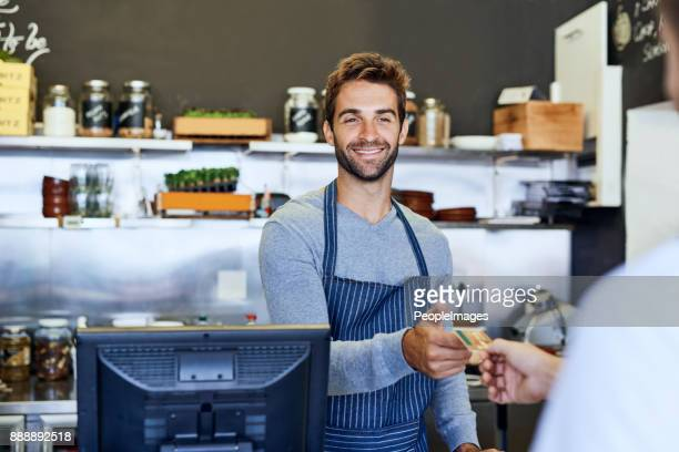 his smile keeps customers in the store - convenient store stock photos and pictures