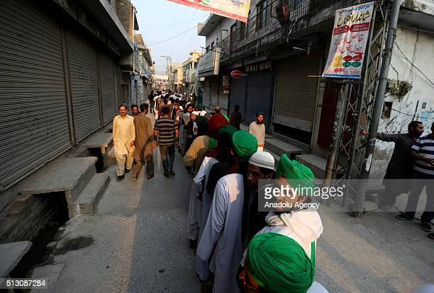 His supporters gather outside the house of Mumtaz Qadri, former police bodyguard who shot dead Punjab's governor Salman Taseer in Islamabad in 2011...