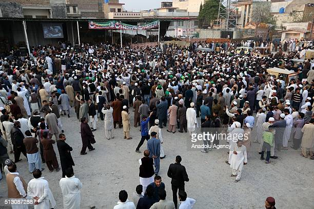 His supporters gather outside the house of Mumtaz Qadri former police bodyguard who shot dead Punjab's governor Salman Taseer in Islamabad in 2011...