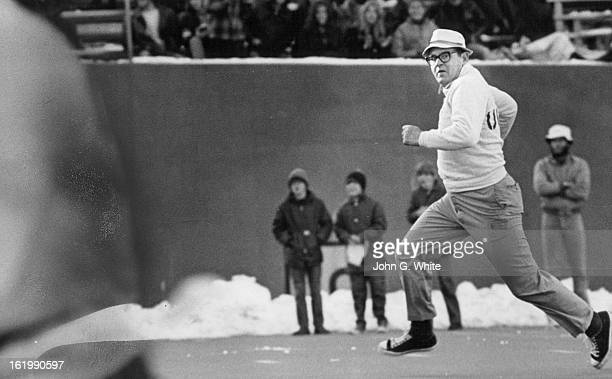 NOV 1971 DEC 7 1971 His tennis shoes flashing over the artificial turf Razorback flanker John Towle chief of the CU police looks frantically for a...