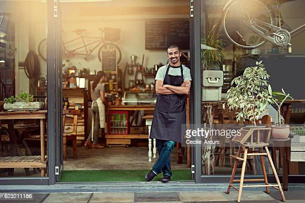 his welcoming smile makes a great first impression - happy merchant stock pictures, royalty-free photos & images
