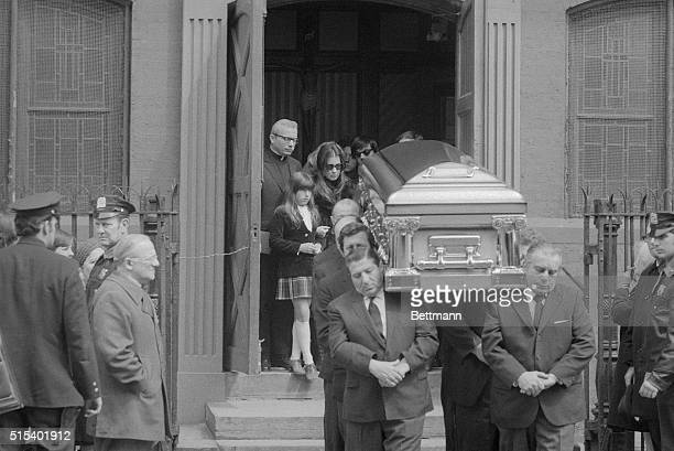 His widow Sina and her daughter Lisa follow close behind the casket of slain Brooklyn Mafia leader Joseph Crazy Joe Gallo following funeral services...
