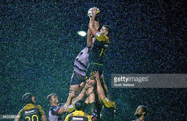 Hisa Sasagi of the Hurricanes and Sam Jeffries of the Rebels compete for the ball in a lineout during the Super Rugby Exhibition match between the...