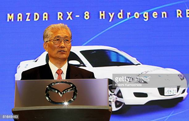 Hisakazu Imaki president and CEO of Mazda Motor Corporation introduces Mazda's prototype car displayd on screen behind him which will soon be...