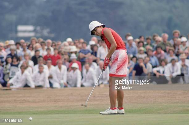 """Hisako """"Chako"""" Higuchi of Japan watches her putt to the hole on her way to winning the Colgate European Women's Open golf tournament on 7th August..."""