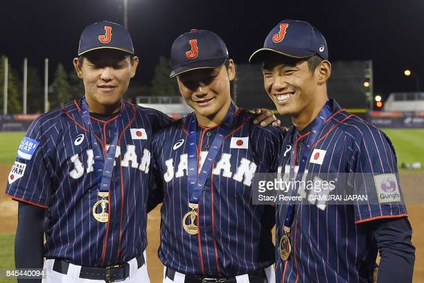 Hisanori Yasuda Kotaro Kiyomiya and Kyota Fujiwara of Japan pose for a picture after beating Canada in the Bronze Medal Game following the WBSC U18...