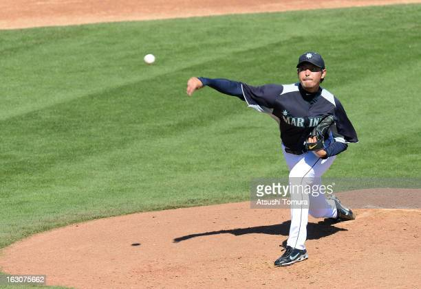 Hisashi Iwakuma of Seattle Mariners throws during the spring training match against Los Angeles Dodgers on March 2, 2013 in Peoria, Arizona.