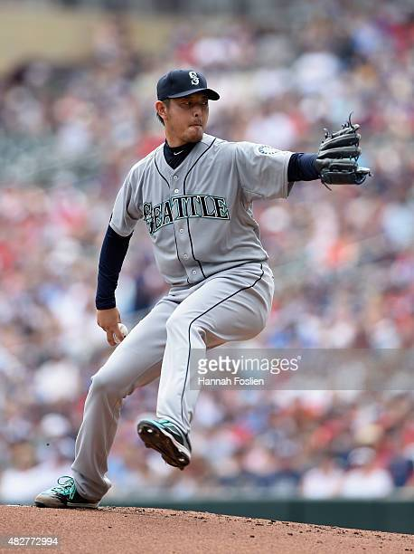 Hisashi Iwakuma of the Seattle Mariners delivers a pitch against the Minnesota Twins during the first inning of the game on August 2 2015 at Target...