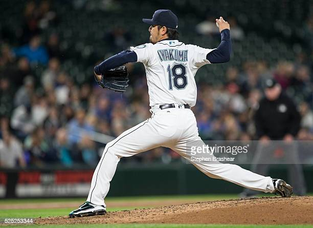 Hisashi Iwakuma of the Seattle Mariners delivers a pitch during the fifth inning of a game against the Houston Astros at Safeco Field on April 27...