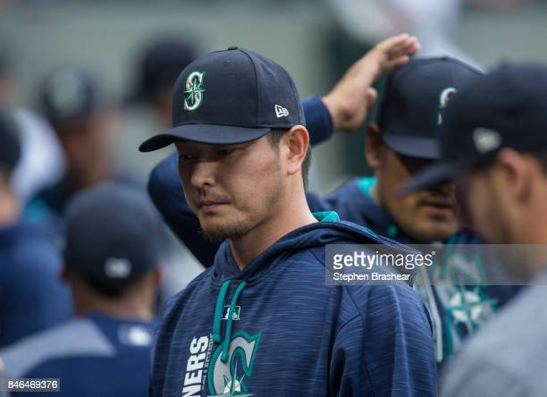 Hisashi Iwakuma of the Seattle Mariners is pictured in the dugout before a game against the Los Angeles Angels of Anaheim at Safeco Field on...