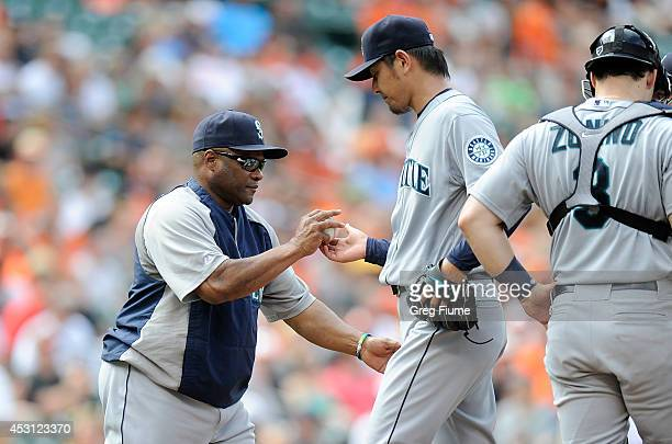 Hisashi Iwakuma of the Seattle Mariners is taken out of the game by manager Lloyd McClendon in the eighth inning against the Baltimore Orioles at...