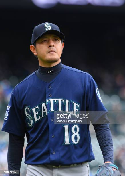 Hisashi Iwakuma of the Seattle Mariners looks on at the end of the third inning of the game against the Detroit Tigers at Comerica Park on April 27...