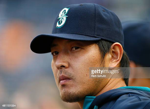Hisashi Iwakuma of the Seattle Mariners looks on from the dugout before the start of a game agains the New York Yankees at Yankee Stadium on July 17...
