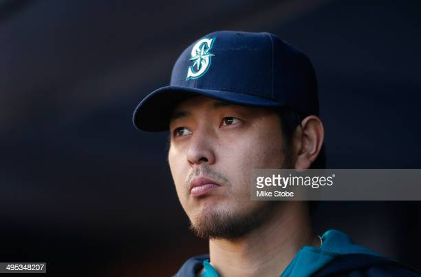 Hisashi Iwakuma of the Seattle Mariners looks on from the dugout during the first inning against the New York Yankees at Yankee Stadium on June 2...