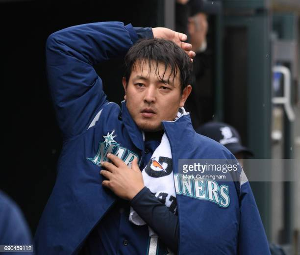 Hisashi Iwakuma of the Seattle Mariners looks on from the dugout during the third inning of the game against the Detroit Tigers at Comerica Park on...