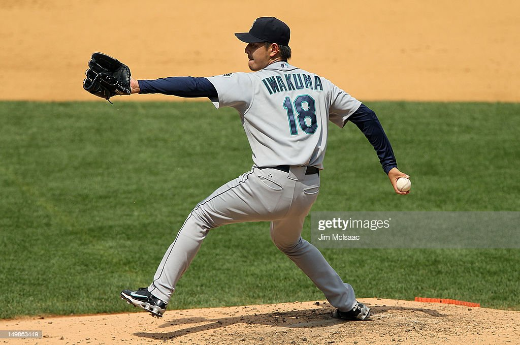 Hisashi Iwakuma #18 of the Seattle Mariners pitches against the New York Yankees at Yankee Stadium on August 5, 2012 in the Bronx borough of New York City.