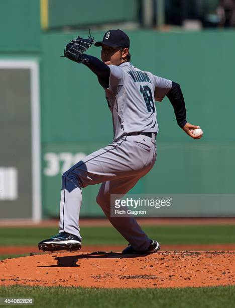 Hisashi Iwakuma of the Seattle Mariners pitches during the first inning against the Boston Red Sox at Fenway Park on August 24 2014 in Boston...
