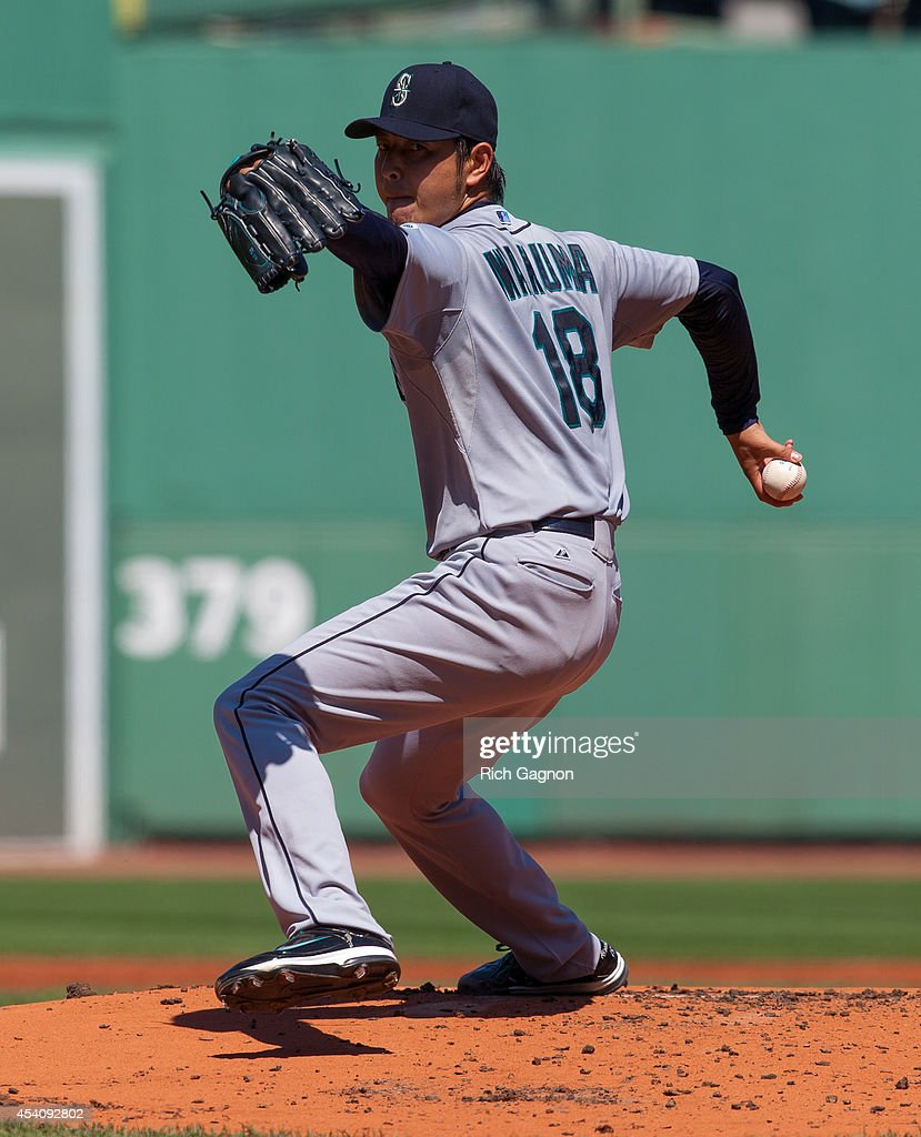 Hisashi Iwakuma #18 of the Seattle Mariners pitches during the first inning against the Boston Red Sox at Fenway Park on August 24, 2014 in Boston, Massachusetts.