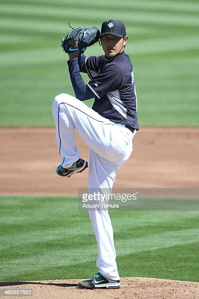Hisashi Iwakuma of the Seattle Mariners pitches during the spring training game between on the Seattle Mariners and Arizona Diamond Backs at the...