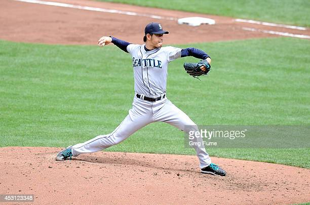 Hisashi Iwakuma of the Seattle Mariners pitches in the fifth inning against the Baltimore Orioles at Oriole Park at Camden Yards on August 3, 2014 in...