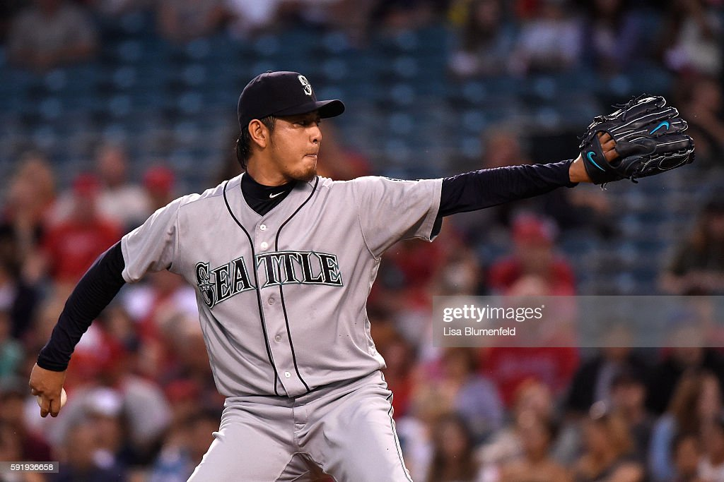 Hisashi Iwakuma #18 of the Seattle Mariners pitches in the first inning against the Los Angeles Angels of Anaheim at Angel Stadium of Anaheim on August 18, 2016 in Anaheim, California.