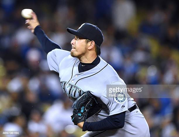 Hisashi Iwakuma of the Seattle Mariners pitches to the Los Angeles Dodgers during the second inning at Dodger Stadium on April 14 2015 in Los Angeles...