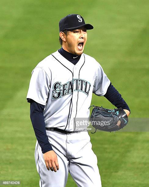 Hisashi Iwakuma of the Seattle Mariners reacts as he leaves the field after his strikeout of Yasmani Grandal of the Los Angeles Dodgers to end the...
