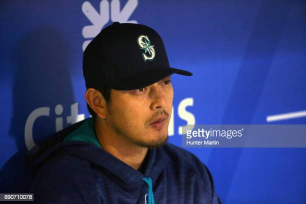 Hisashi Iwakuma of the Seattle Mariners sits in the dugout in the third inning during a game against the Philadelphia Phillies at Citizens Bank Park...