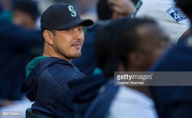 Hisashi Iwakuma of the Seattle Mariners sits on the bench in the dugout during a game against the Detroit Tigers at Safeco Field on June 22 2017 in...