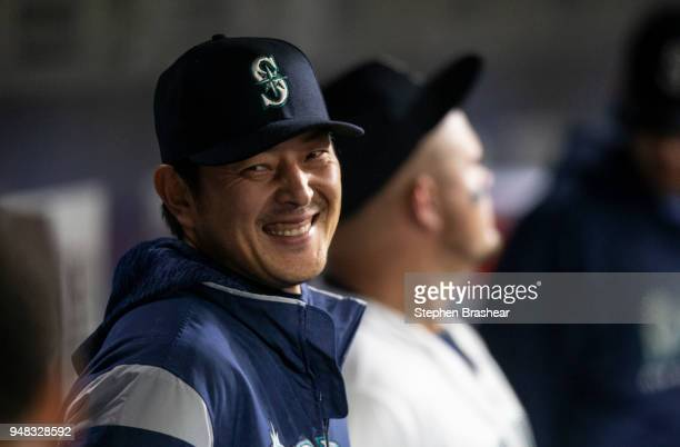 Hisashi Iwakuma of the Seattle Mariners smiles while standing in the dugout before a game at Safeco Field against the Oakland Athletics on April 14...