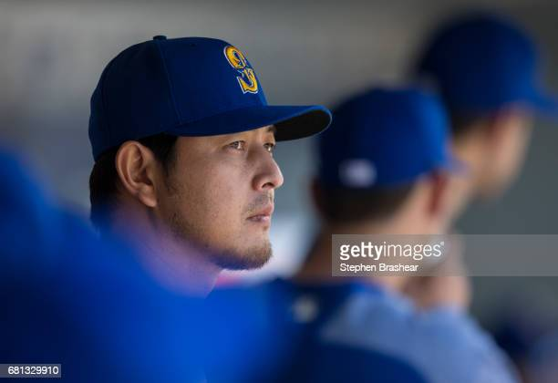 Hisashi Iwakuma of the Seattle Mariners stands in the dugout before a game against the Texas Rangers at Safeco Field on May 7 2017 in Seattle...
