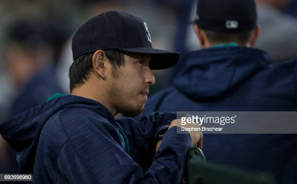 Hisashi Iwakuma of the Seattle Mariners stands in the dugout before a game Colorado Rockies at Safeco Field on May 31 2017 in Seattle Washington The...