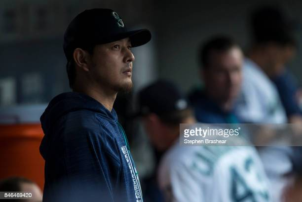 Hisashi Iwakuma of the Seattle Mariners stands in the dugout before a game against the Los Angeles Angels of Anaheim at Safeco Field on September 9...
