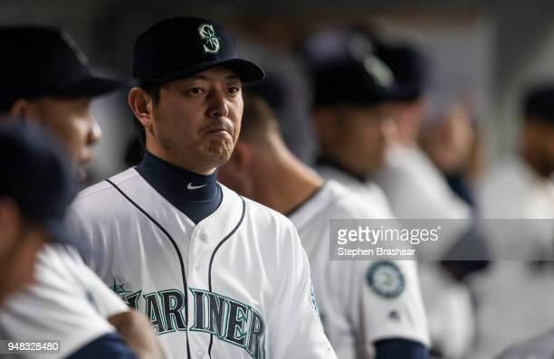 Hisashi Iwakuma of the Seattle Mariners stands in the dugout before a game against the Oakland Athletics at Safeco Field on April 14 2018 in Seattle...