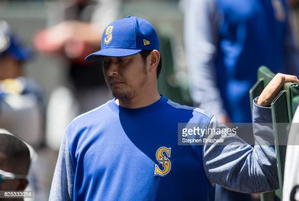 Hisashi Iwakuma of the Seattle Mariners stands in the dugout before an interleague game against the New York Mets at Safeco Field on July 30 2017 in...