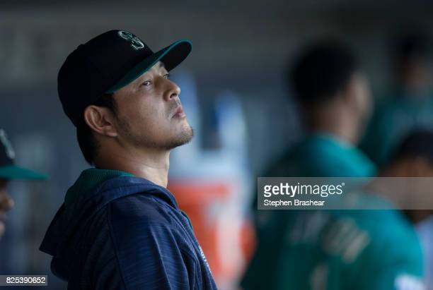 Hisashi Iwakuma of the Seattle Mariners stands in the dugout before an interleague against the New York Mets game at Safeco Field on July 28 2017 in...