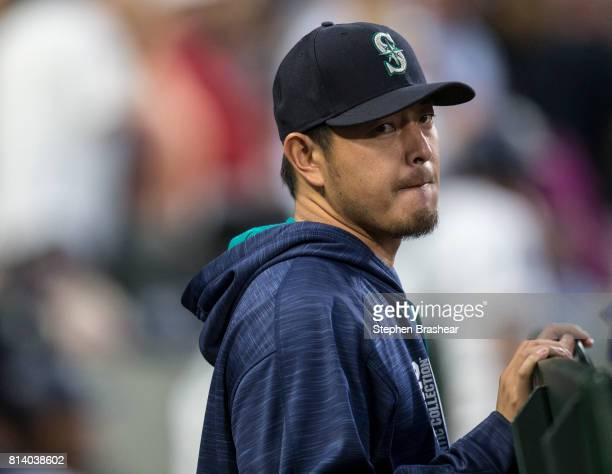 Hisashi Iwakuma of the Seattle Mariners stands in the dugout during a game against the Oakland Athletics at Safeco Field on July 8 2017 in Seattle...