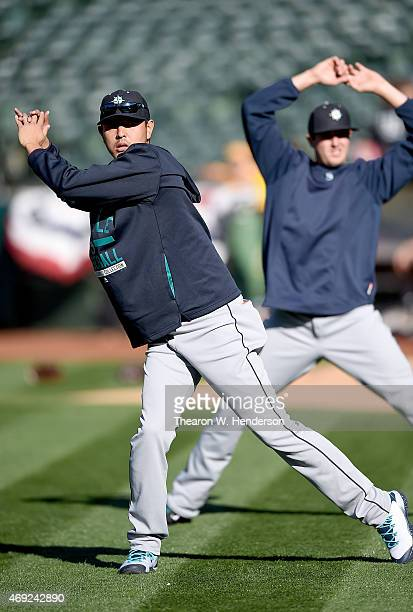 Hisashi Iwakuma of the Seattle Mariners stretches and warms up prior to the game against the Oakland Athletics at Oco Coliseum on April 10 2015 in...