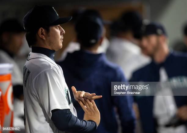 Hisashi Iwakuma of the Seattle Mariners stretches in the dugout before a game against the Oakland Athletics at Safeco Field on April 14 2018 in...