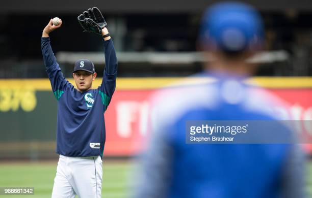 Hisashi Iwakuma of the Seattle Mariners stretches while throwing on the field before a game against the Tampa Bay Rays at Safeco Field on June 3 2018...
