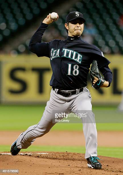 Hisashi Iwakuma of the Seattle Mariners throws in the first inning against the Houston Astros at Minute Maid Park on July 1 2014 in Houston Texas